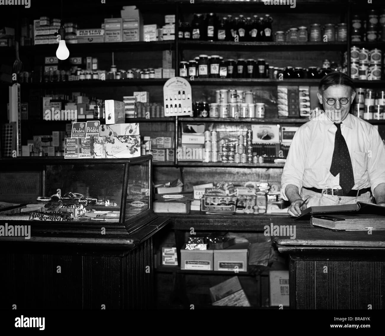 General Store Stock Photos General Store Stock Images: 1930s GENERAL STORE INTERIOR GROCER OWNER BEHIND COUNTER