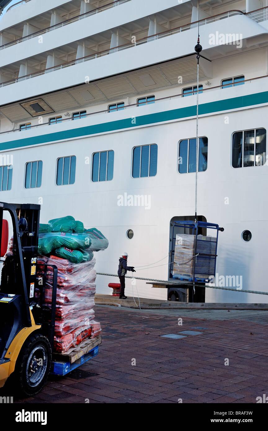 A Fork Lift Truck Loading Supplies Into A Cruise Ship Stock Photo - Cruise ship supplies