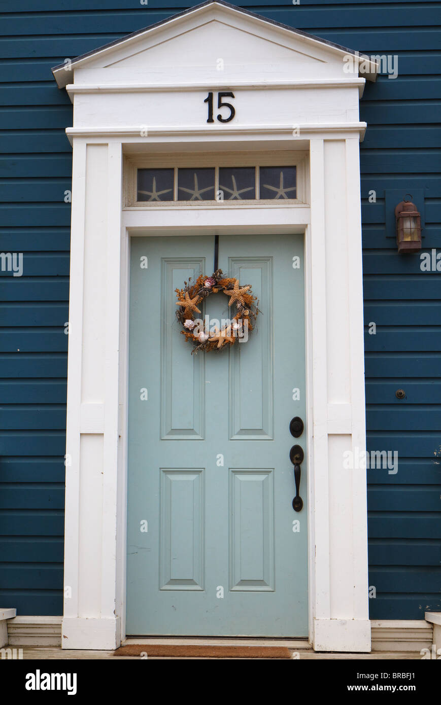 Pastle blue door with white trim against dark blue wall in early American style & Pastle blue door with white trim against dark blue wall in early ...