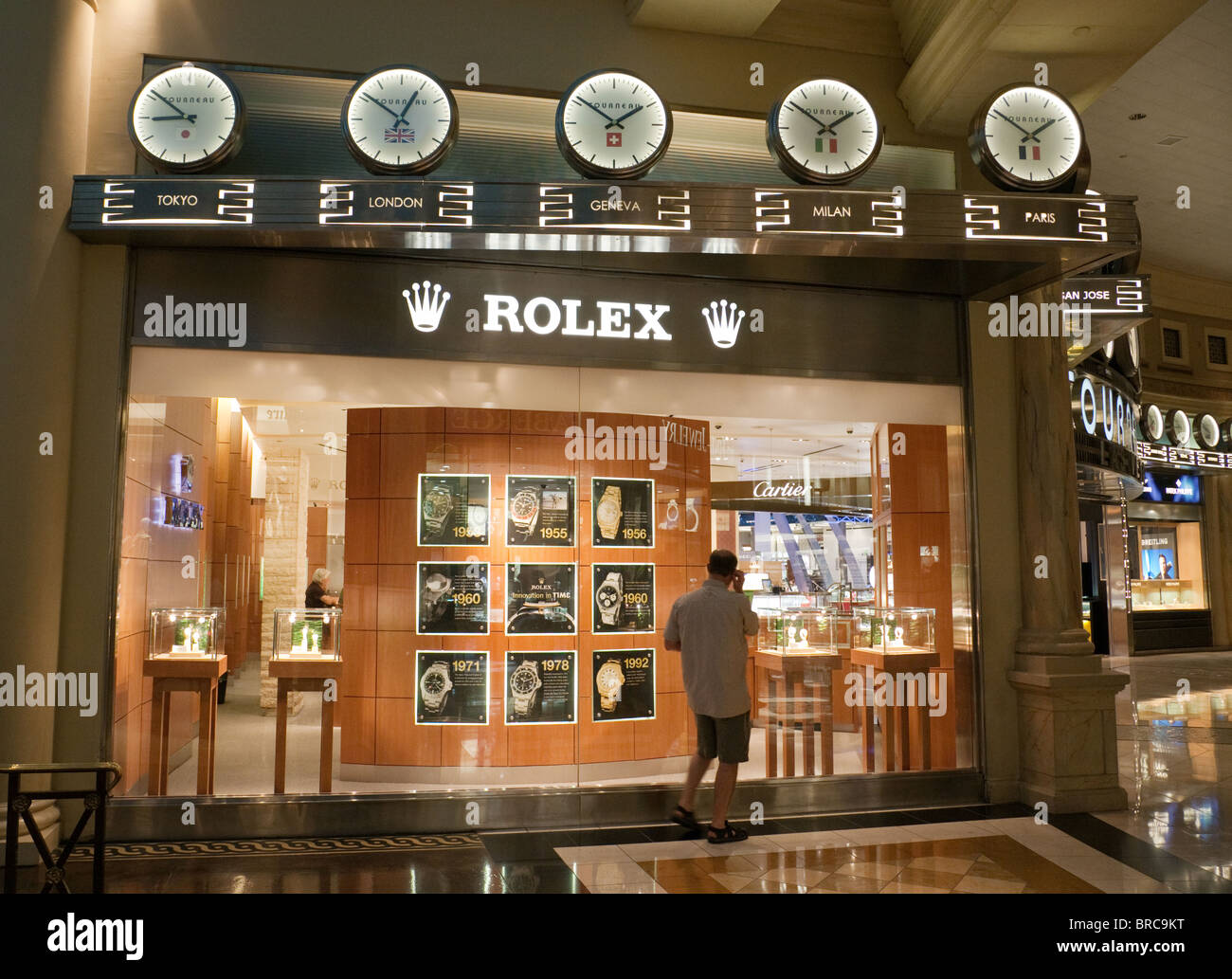 a person shopping at the rolex store the forum shops caesars palace stock photo royalty free. Black Bedroom Furniture Sets. Home Design Ideas