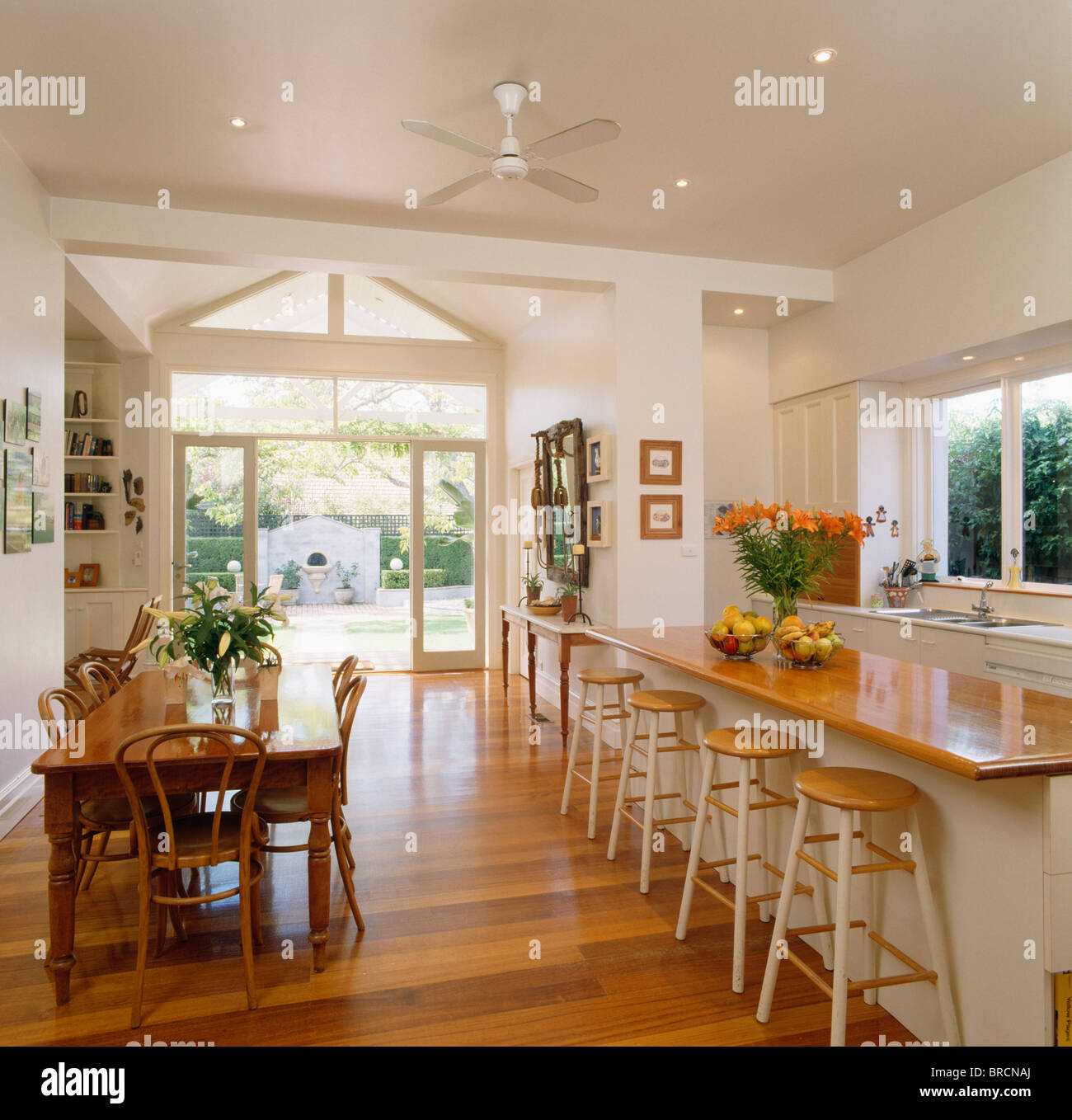 Old pine table and bentwood chairs in dining area of large open-plan kitchen with : bentwood kitchen stools - islam-shia.org