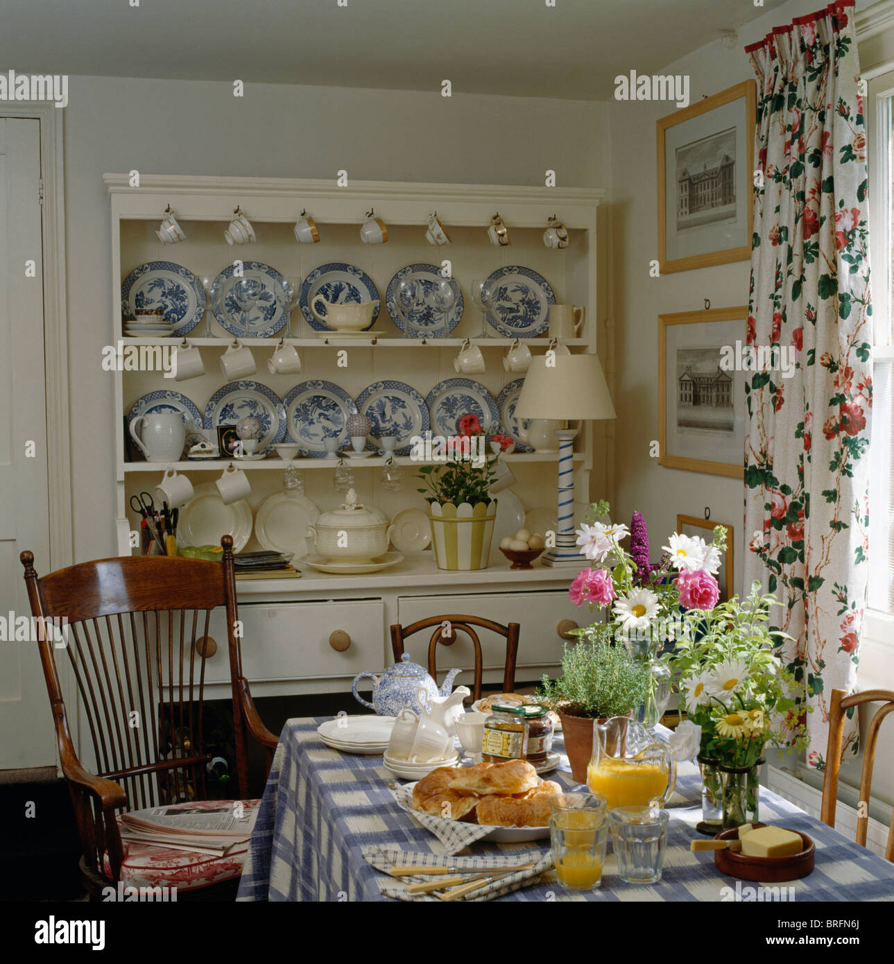 Blue White China Collection On Cream Dresser In Cottage Dining Room With Table Set For Breakfast Checked Cloth