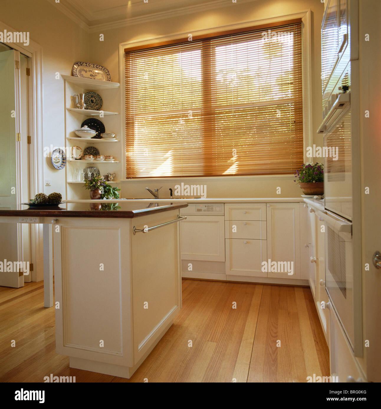 White Kitchen Blinds: Wooden Venetian Blind On Window In Modern White Kitchen
