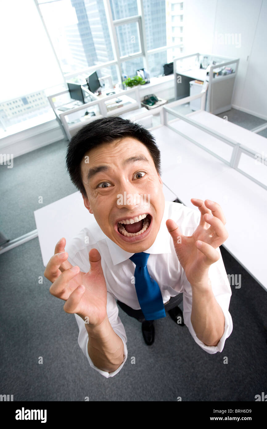 Frustrated office worker on the phone holding stock photo image - Frustrated Office Worker