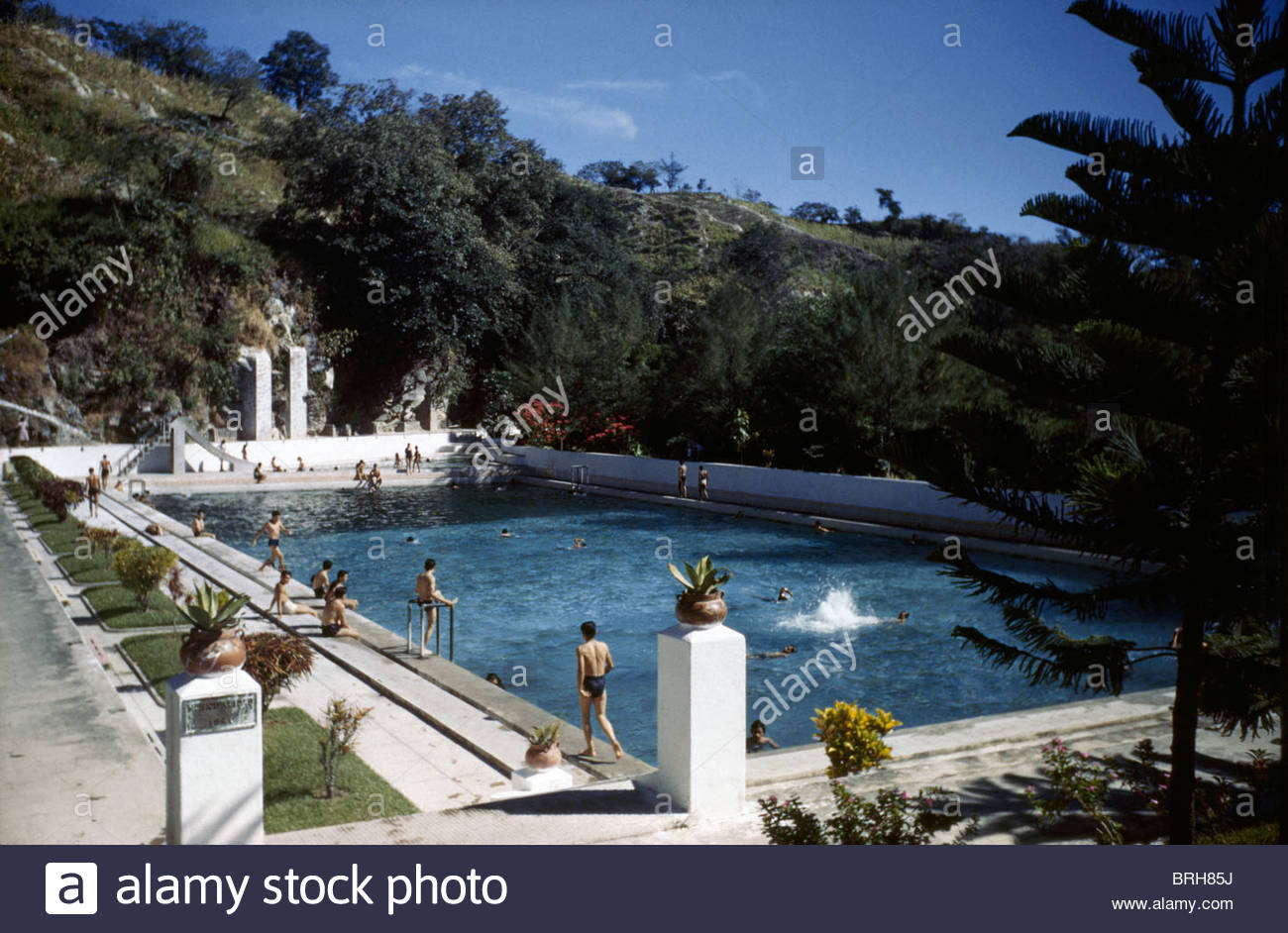 People Swim In A Public Swimming Pool Fed By Warm Natural Springs