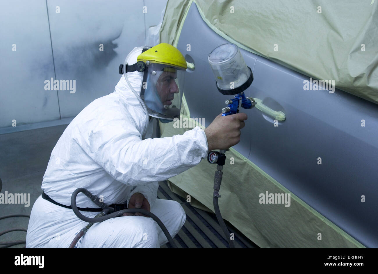stock photo a man in a spray paint booth works on a car repair uk. Black Bedroom Furniture Sets. Home Design Ideas