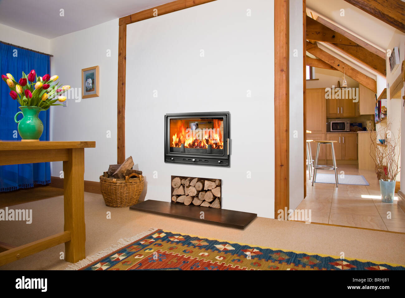 a woodfire rs15d two sided wood burning stove in a dining room and