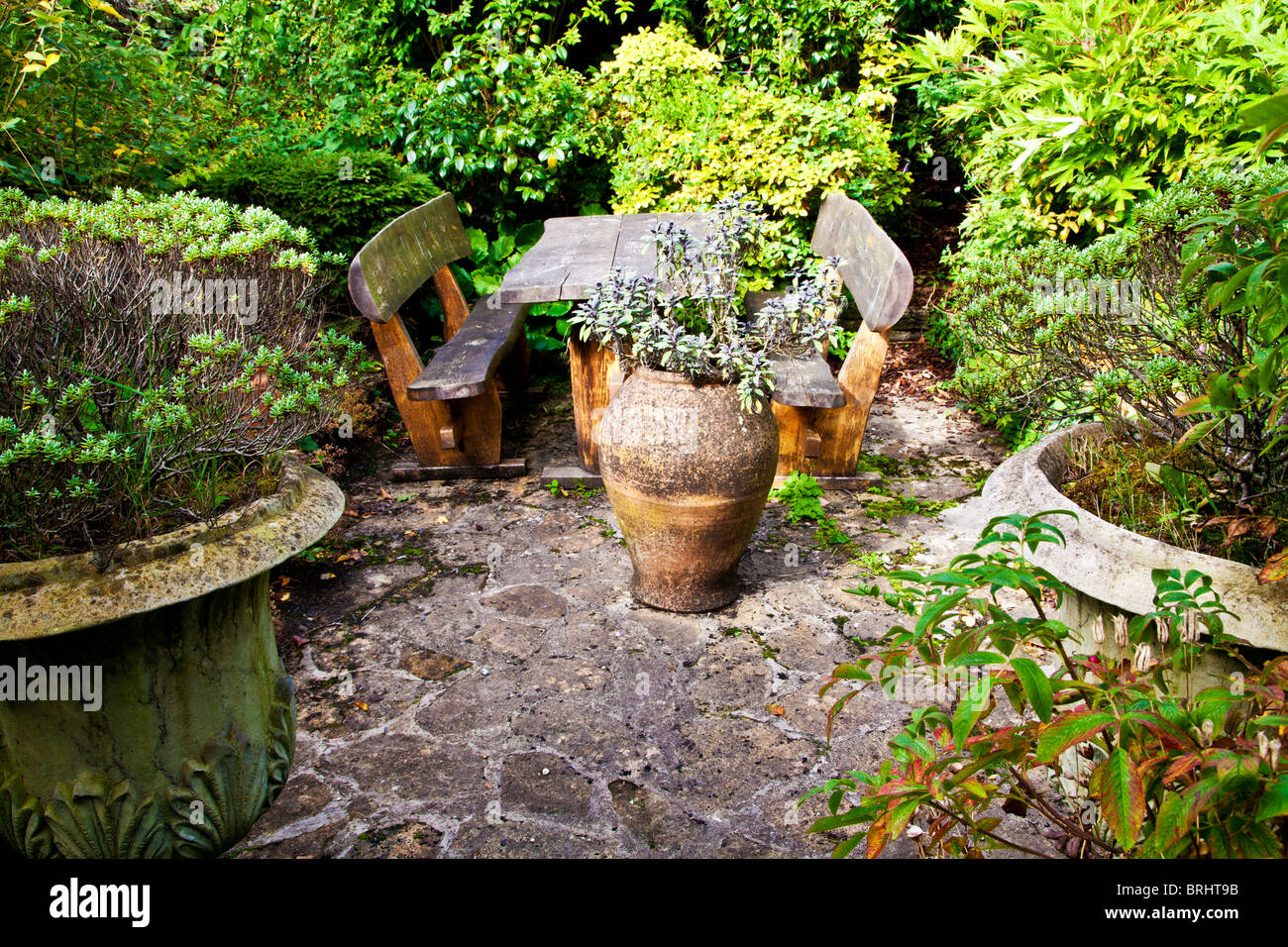 A quiet courtyard corner with picnic table in an english for English courtyard garden design
