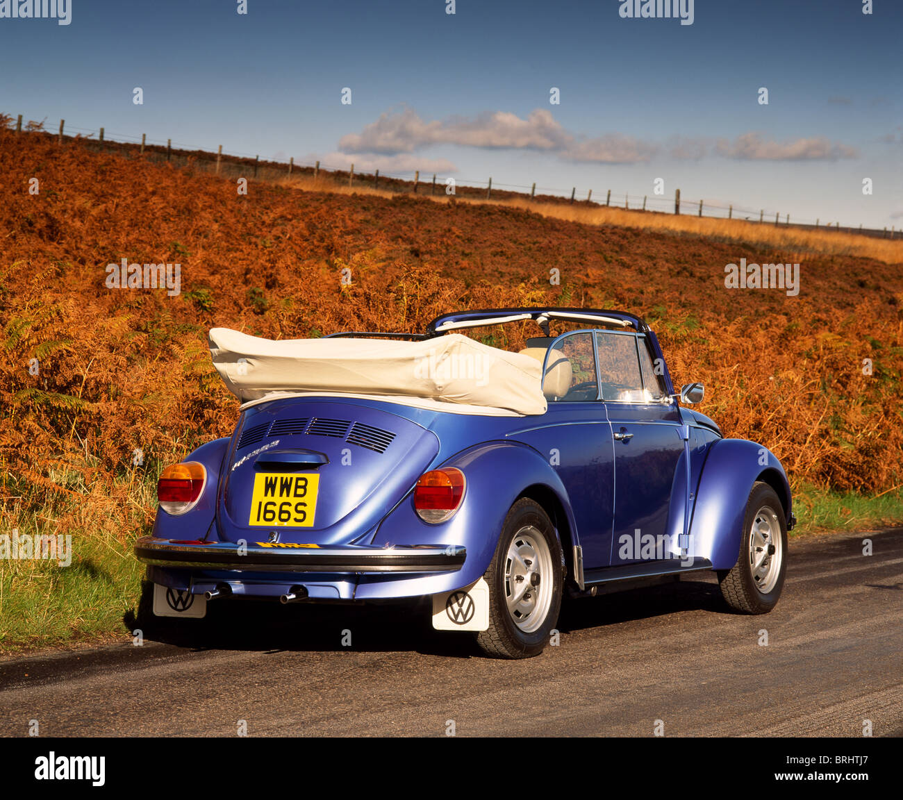 1975 vw beetle 1303 cabriolet parked on country road rear view roof down