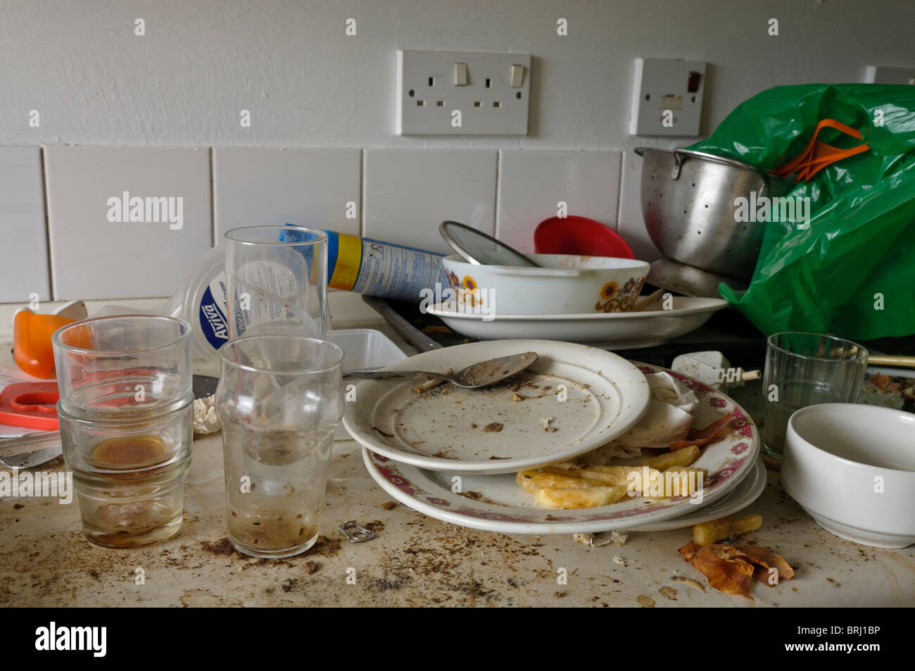 Dirty plate on a dirty kitchen worktop Stock Photo, Royalty Free ...