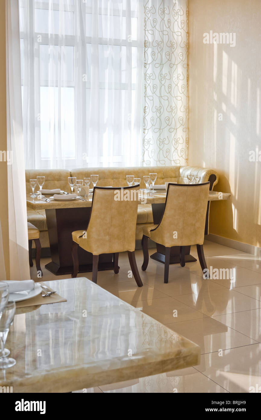 restaurant interior of beige colours with leather seats stock