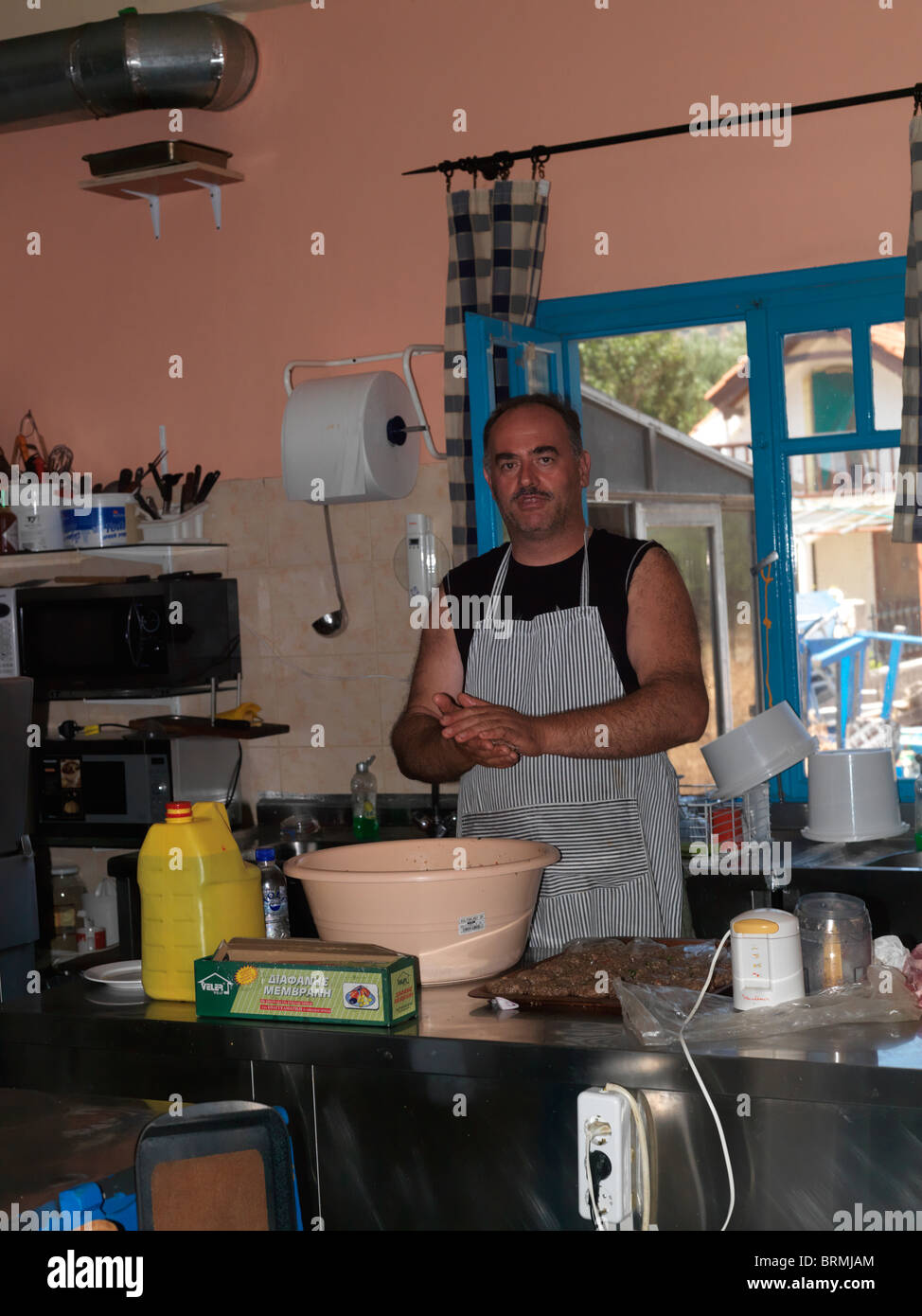 Limnionas Samos Greece Man Cooking In Restaurant Kitchen Stock ...