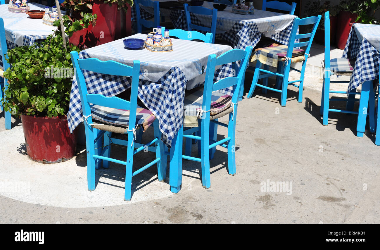 Traditional blue greek restaurant table and chairs image