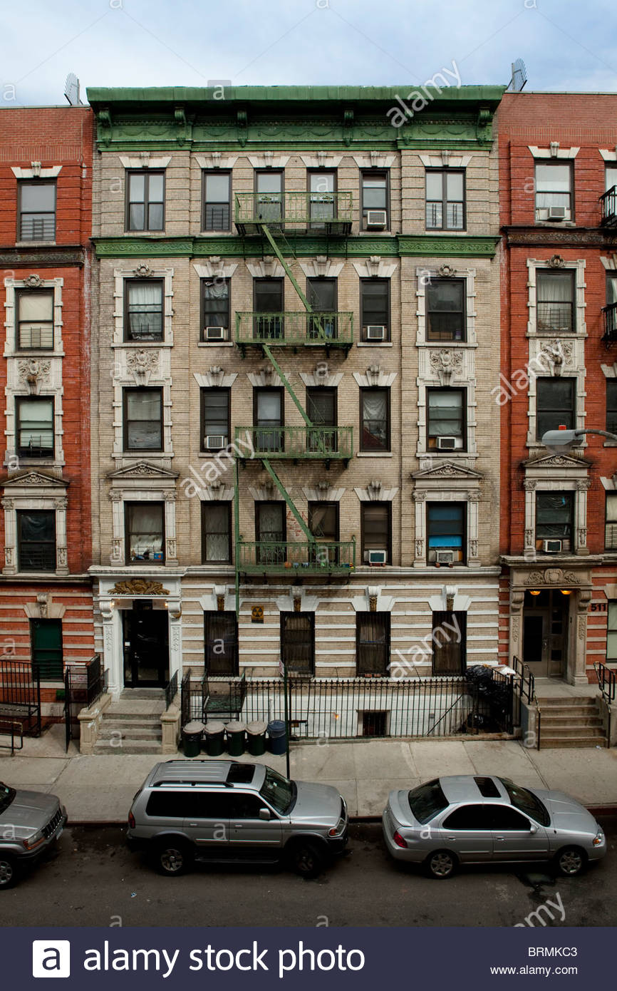Apartment Building Front front view of old harlem tenement building stock photo, royalty