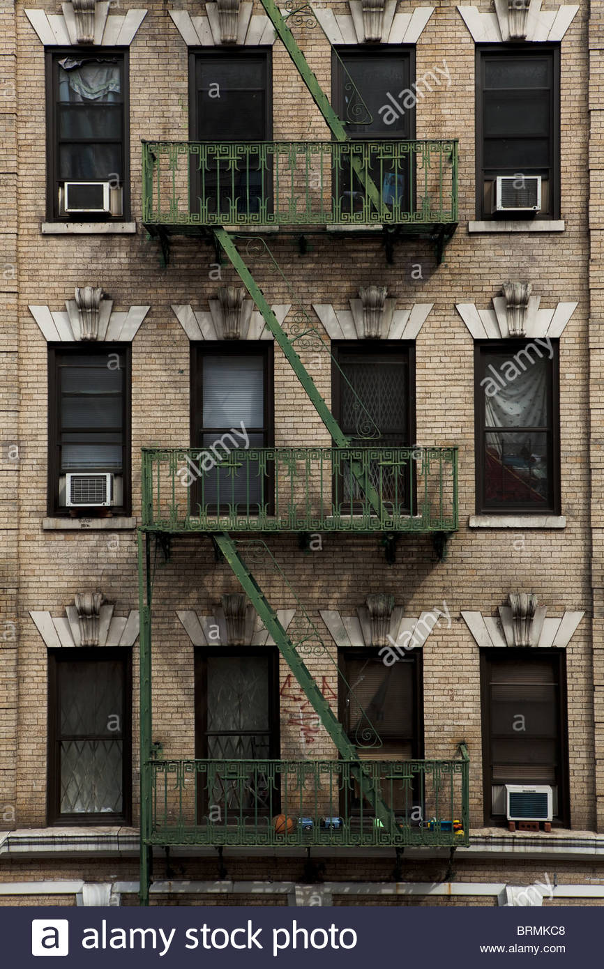 Front view of old harlem tenement building stock photo for Exterior view of building