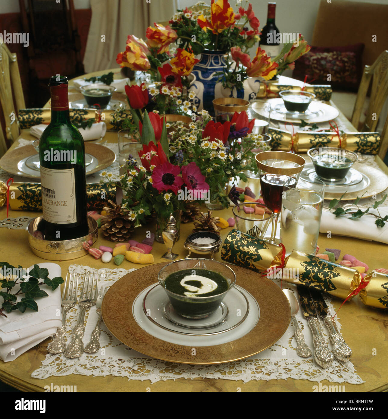 Christmas Lunch Table Decoration Ideas : Close up of place settings and floral decorations on table