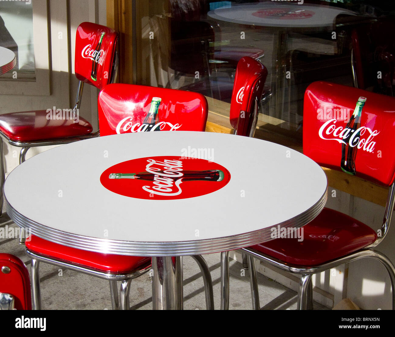 Red coca cola chairs around a white coca cola table stock photo 31828993 alamy - Coca cola table and chairs set ...