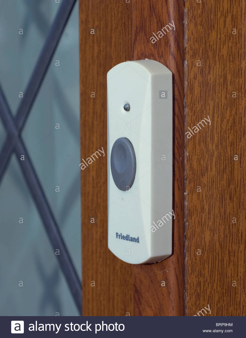 Stock Photo   Wireless Front Door Bell Button Attached To Wooden Door Frame
