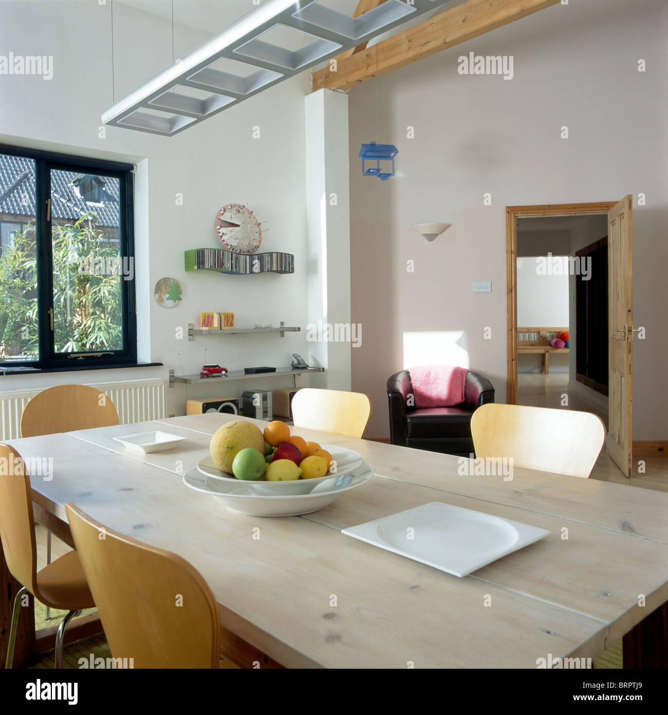Modern country dining room - Pale Wood Table And Modern Plywood Chairs In Modern Country Dining Room Extension