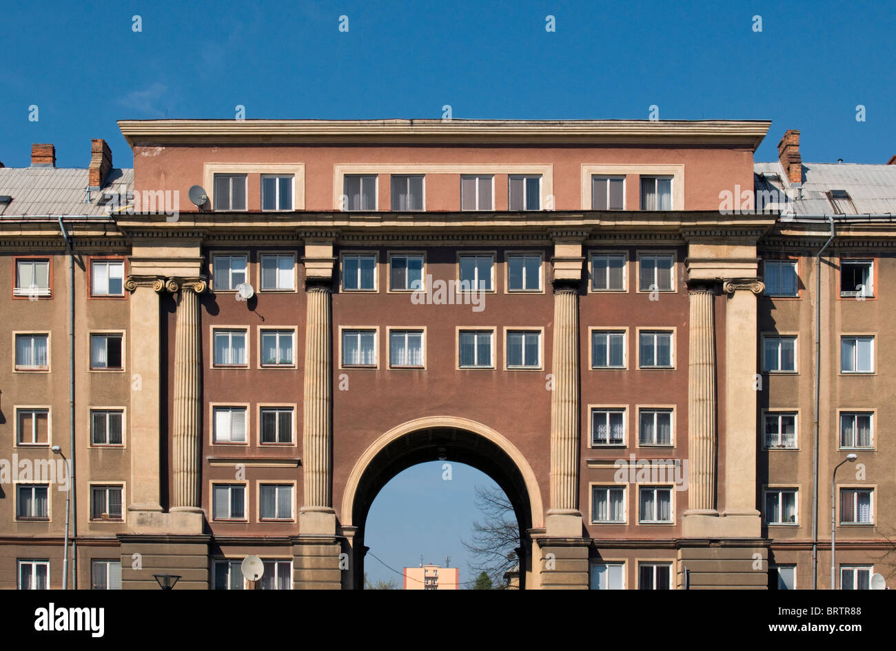 Apartment building with arch in 1950s socialist realism for Architecture 1950