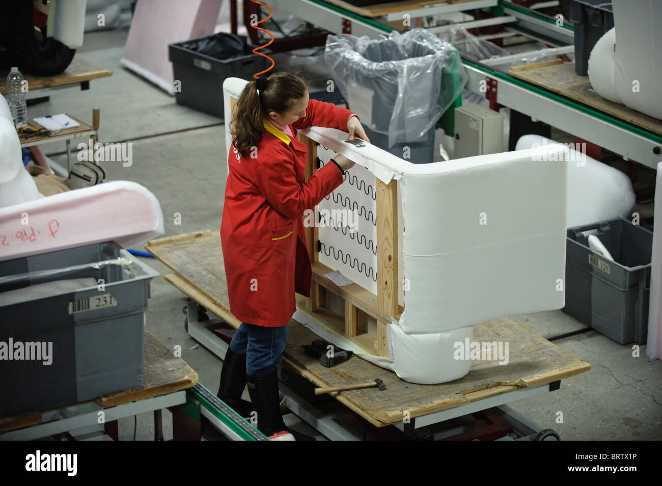 Worker assembling a sofa frame at ikea supplier aquinos for Factory sofas