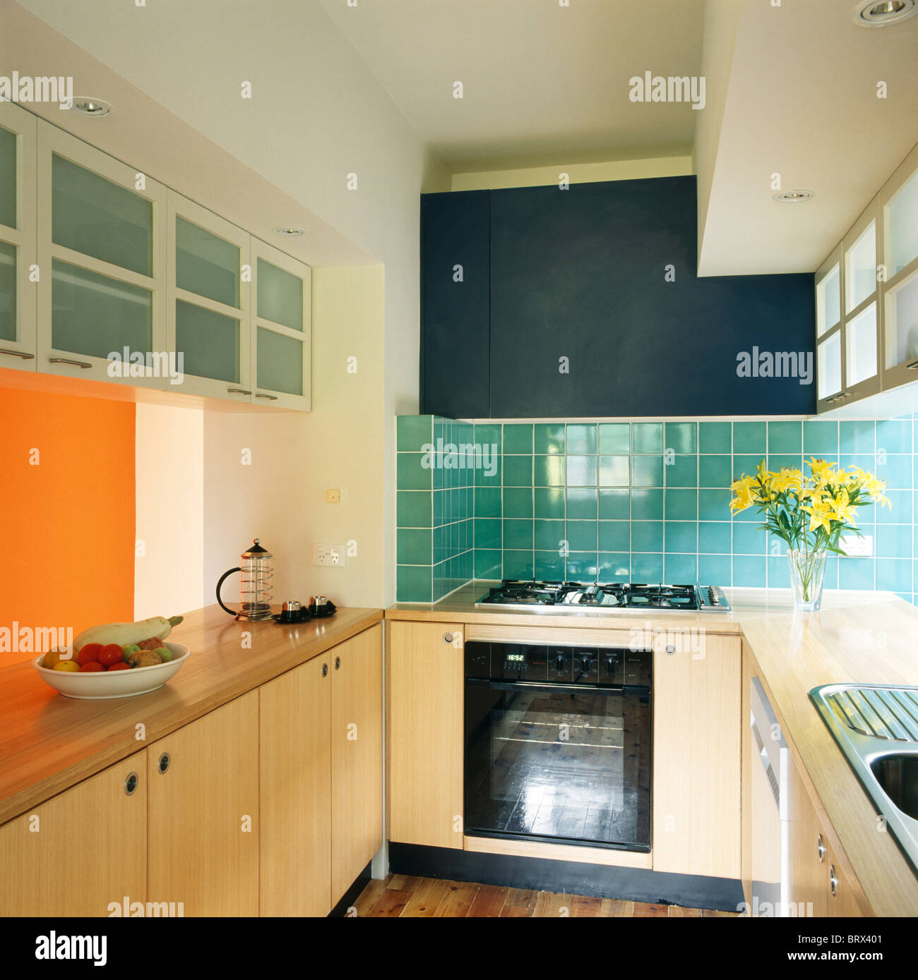 Modern Kitchen Units modern kitchen - turquoise kitchen units & cupboards stock photo