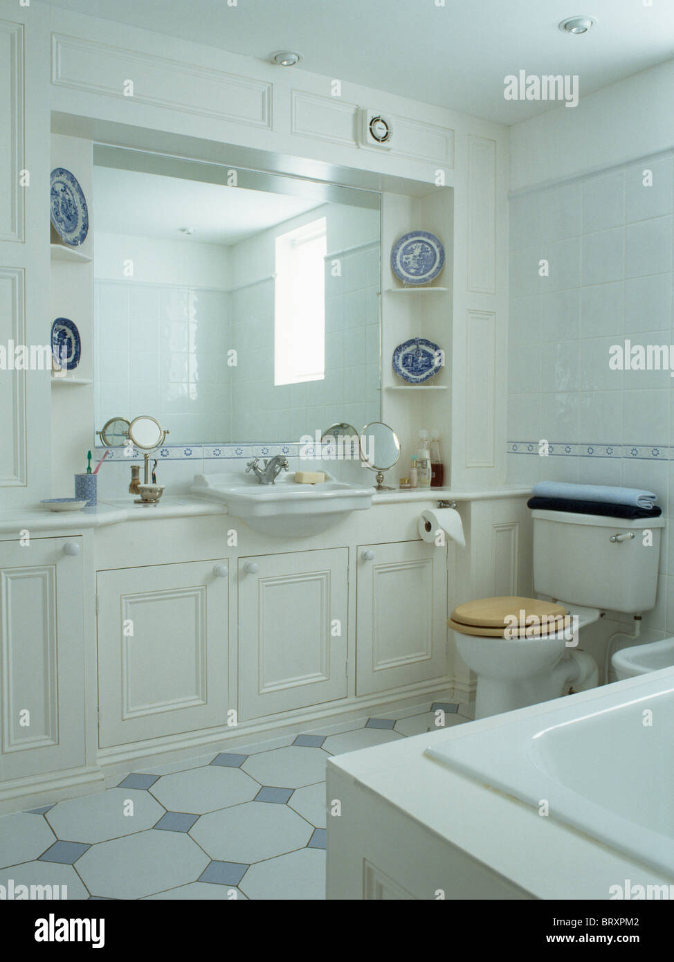Traditional White Bathrooms Mirror Above Basin In White Vanity Unit In Traditional White