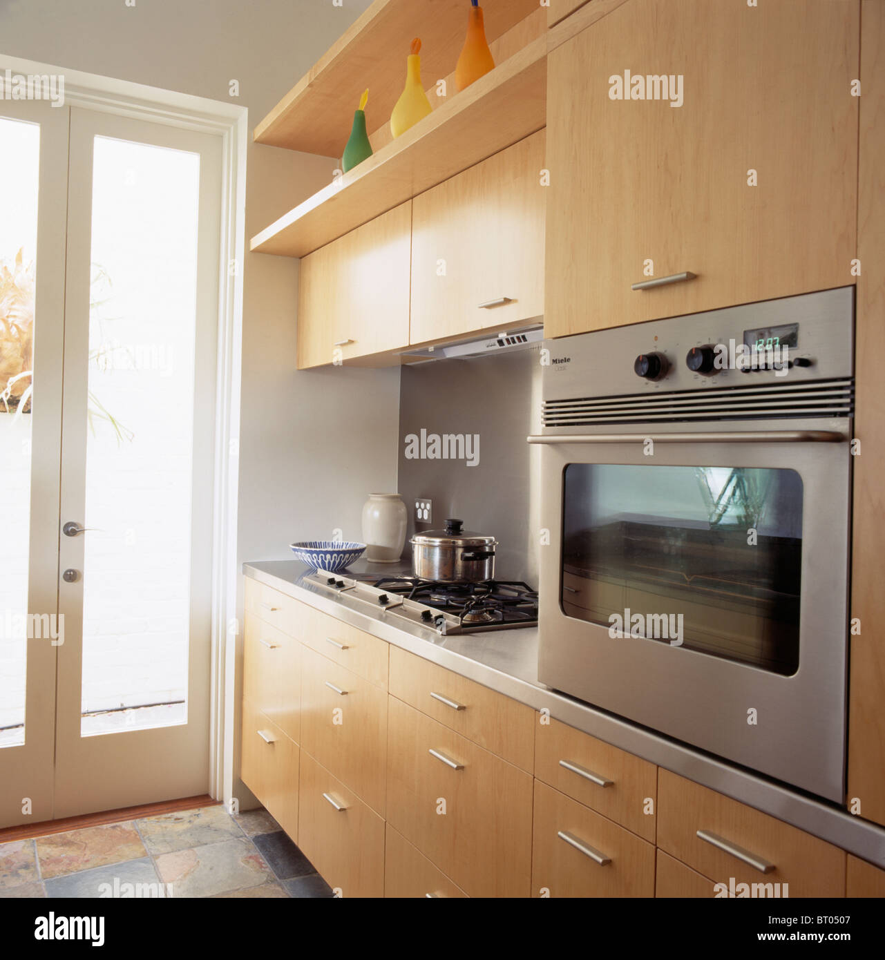 eye level stainless steel oven in pale wood fitted unit in. Black Bedroom Furniture Sets. Home Design Ideas