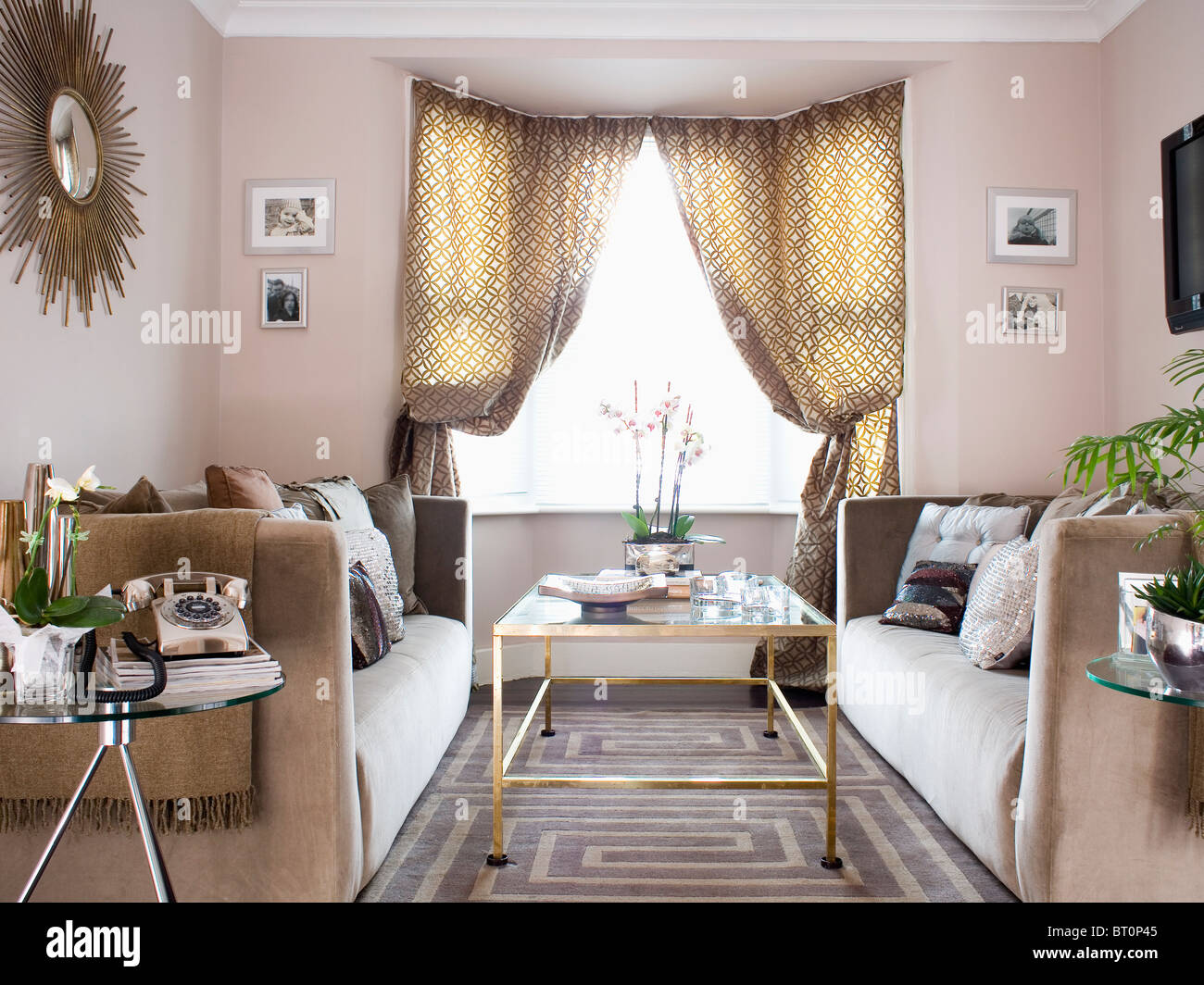 Delightful Patterned Curtains On Window In Modern Beige Living Room With  Patterned Rug And Glass Topped