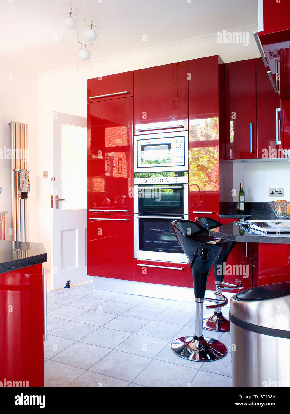 Double Ovens In Red Acrylic Tower Units In Modern Kitchen