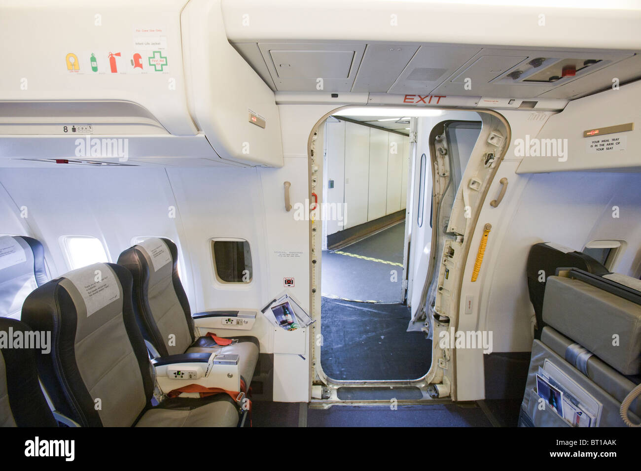 An exit door on a jet plane. - Stock Image & Emergency Exit Door Plane Stock Photos \u0026 Emergency Exit Door Plane ... Pezcame.Com