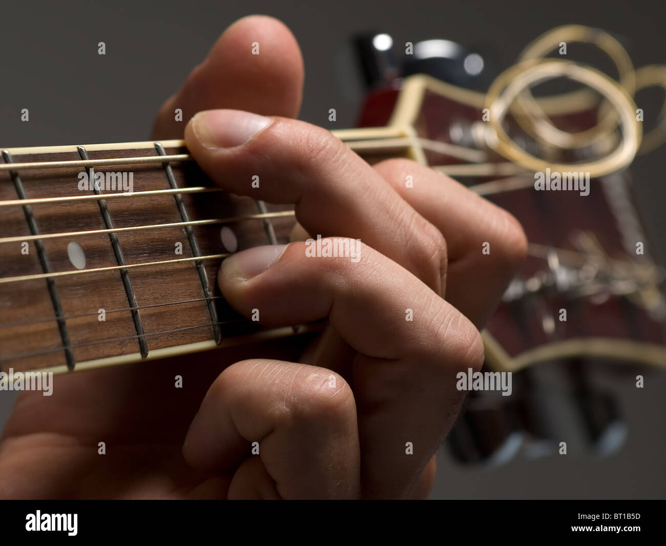 Man Playing Chord On The Acoustic Guitarshallow Dof Useful For