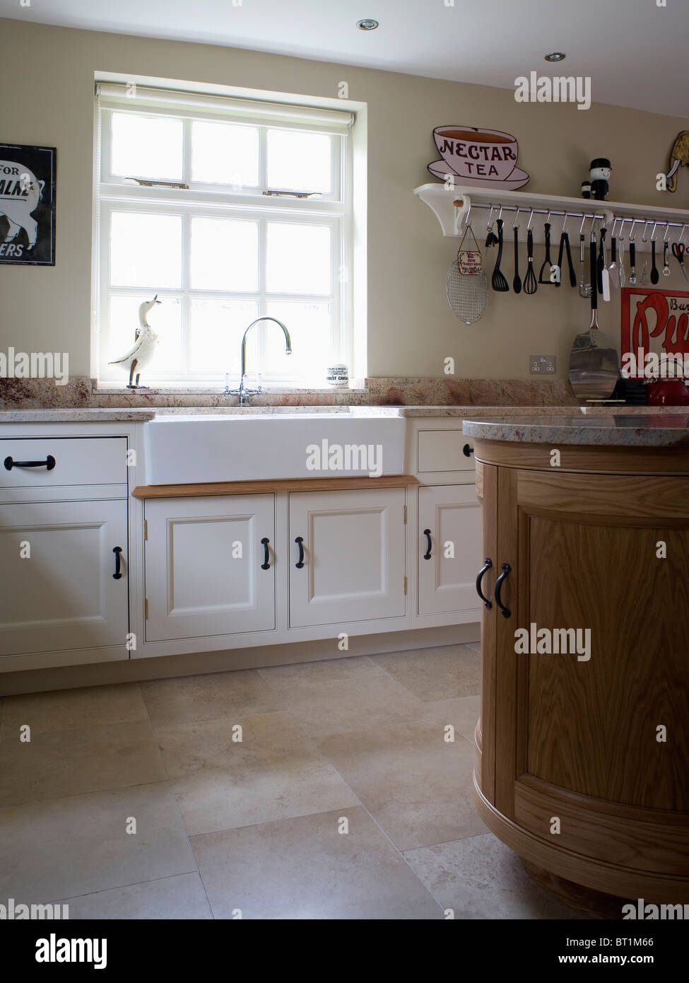 Belfast Sink Below Window In Cream Country Kitchen With Limestone Flooring