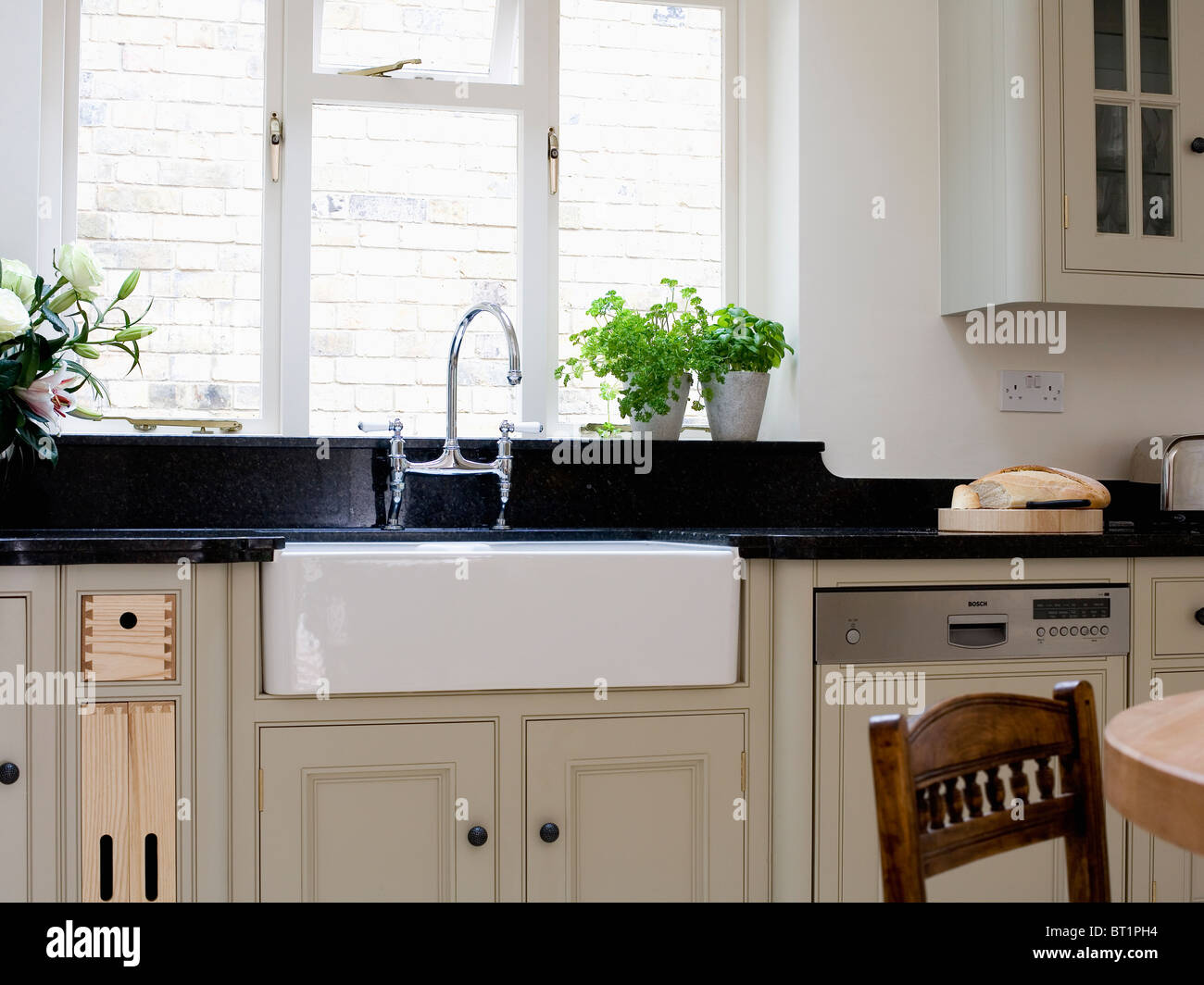 Belfast Sink Below Window In Modern Kitchen Stock Photo Royalty Free Image 32001792 Alamy