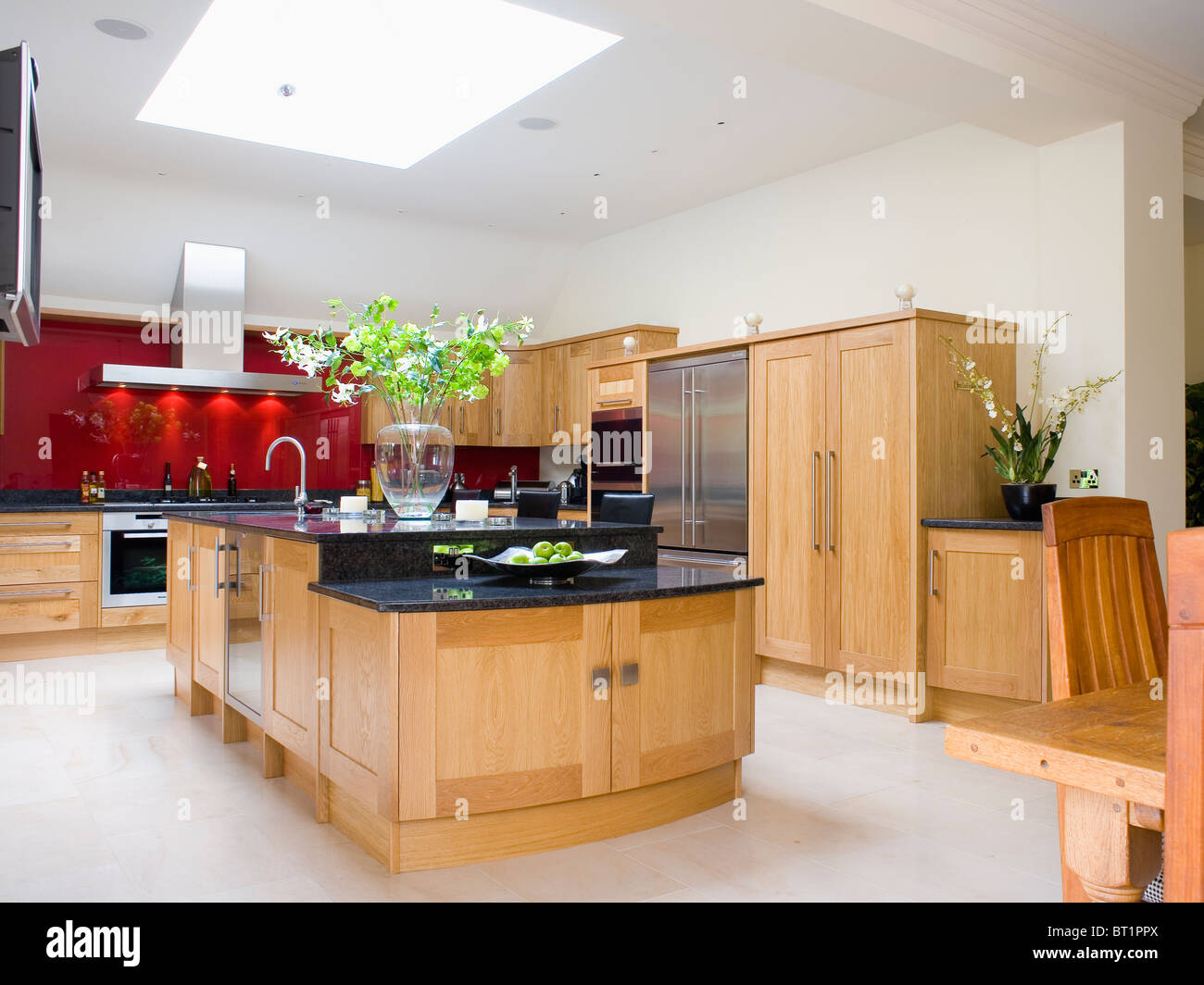 Limestone Flooring In Kitchen Limestone Flooring And Pale Wood Units In Open Plan Kitchen And
