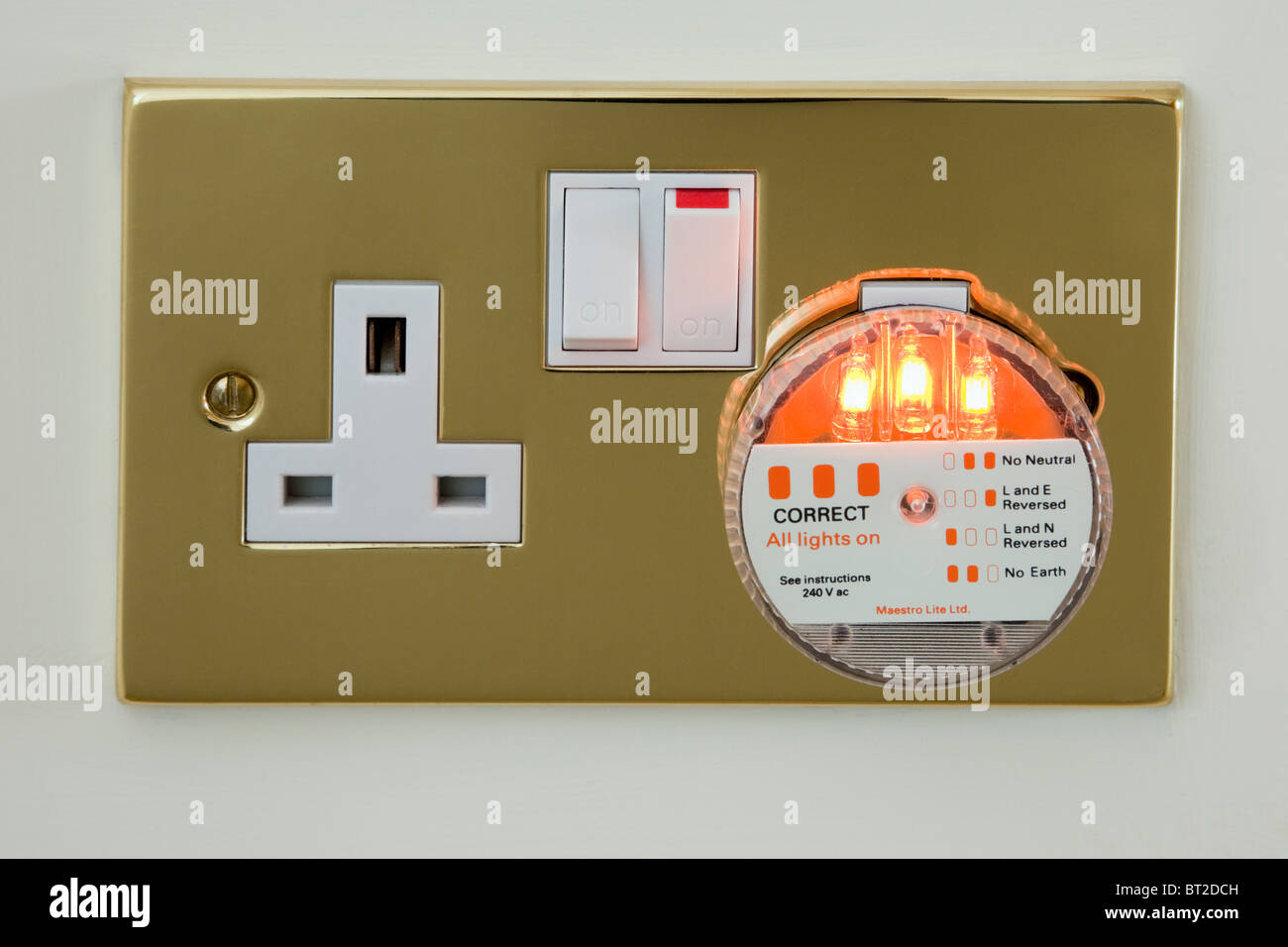 UK Electric Wall Socket Tester Plug Checking Mains Electricity Wiring With Three Indicator Lights On To Show Correct Connections