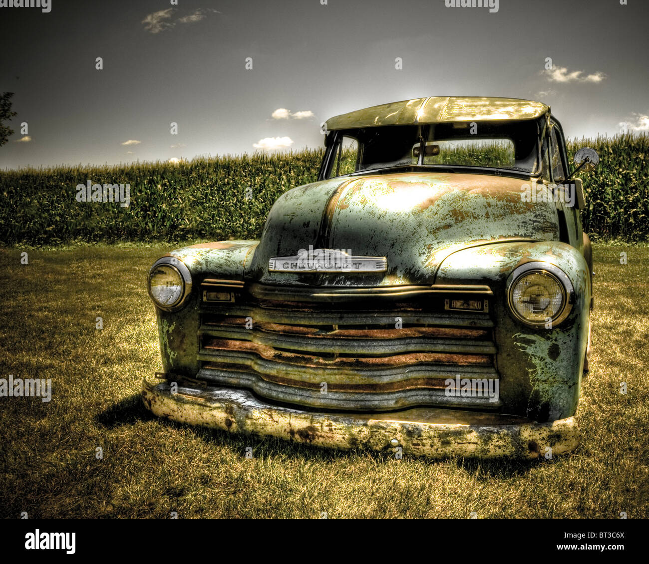 Vintage chevy truck planted in the ground outdoors under hot sun stock image