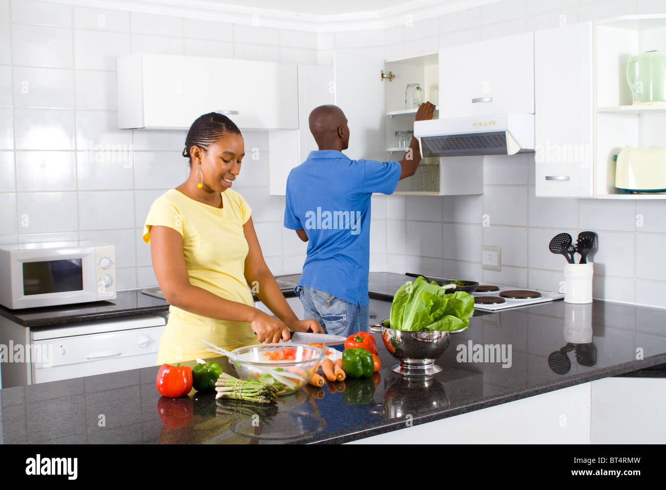Home Kitchen Cooking African Couple Cooking In Home Kitchen Stock Photo Royalty Free