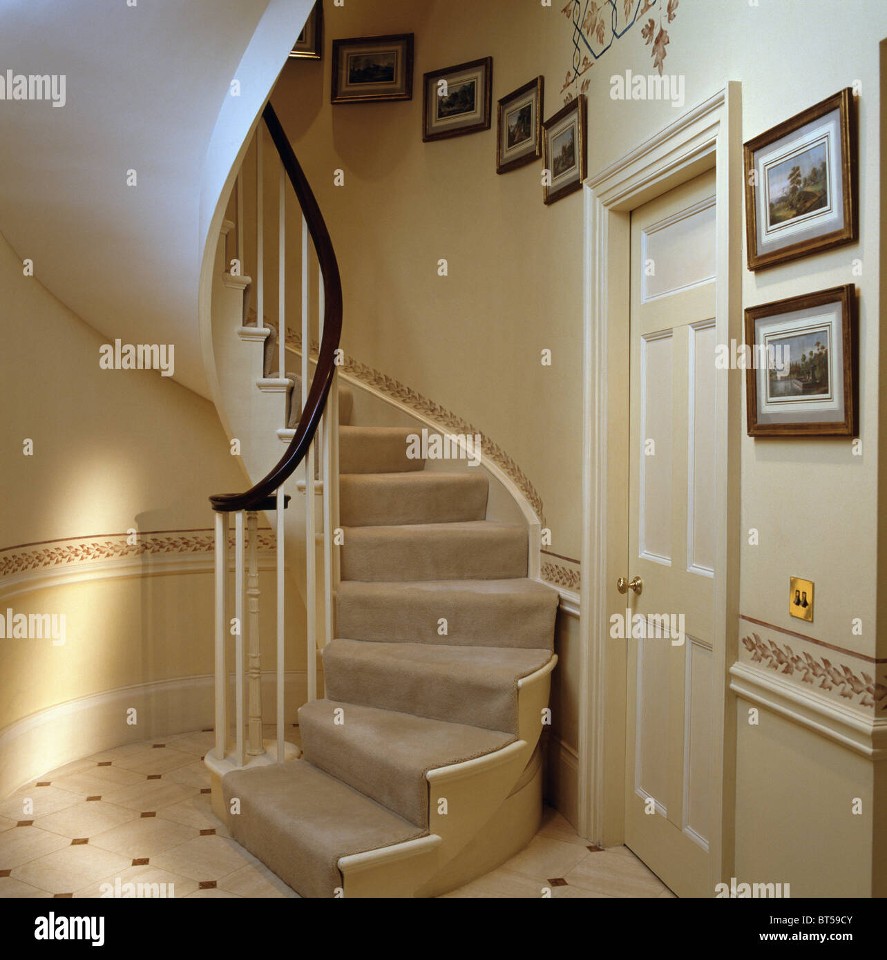 Cream Carpet On Curved Staircase In Traditional Cream Hall