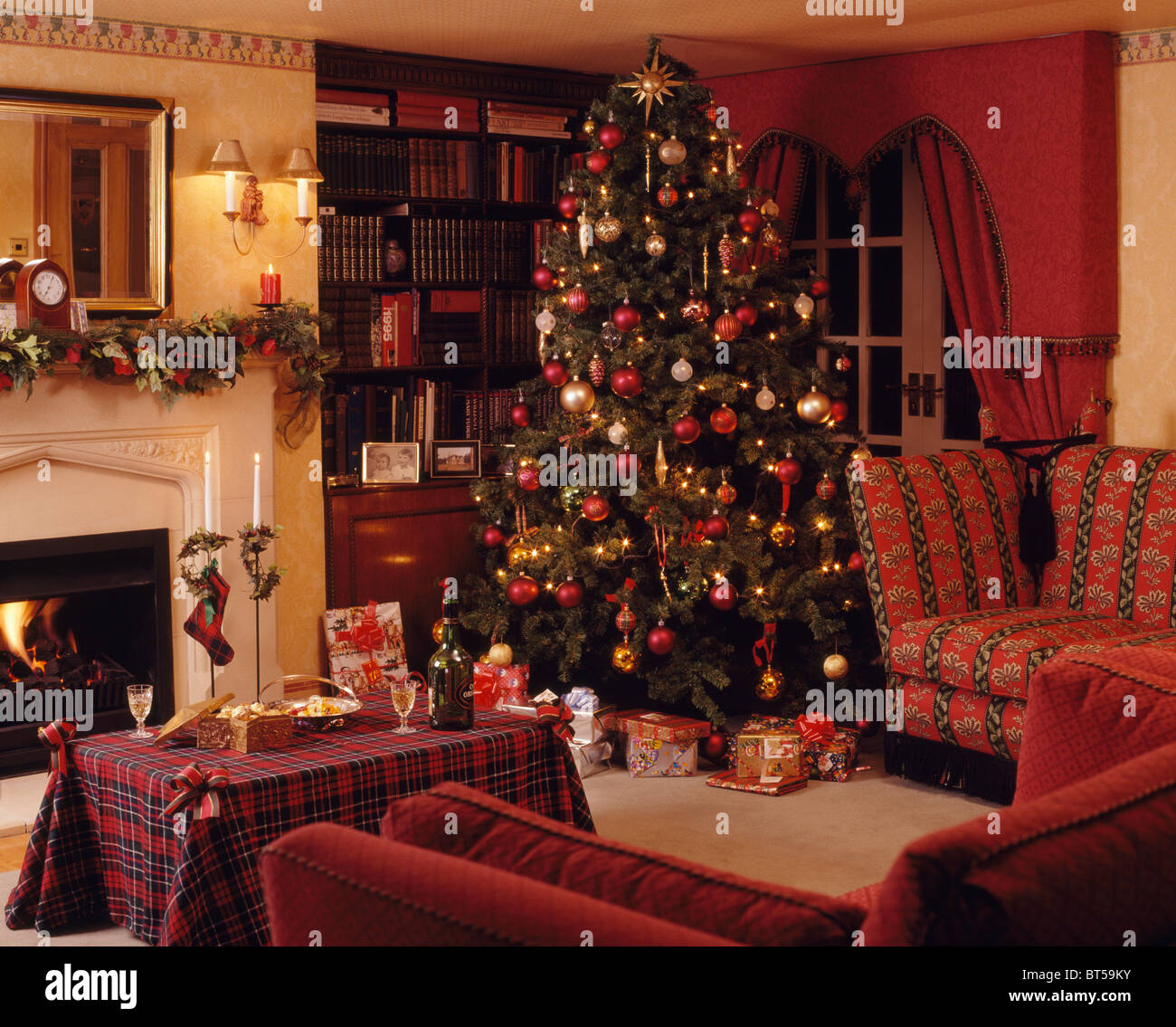 How To Decorate A Live Christmas Tree: Wrapped Gifts Below Christmas Tree In Corner Of