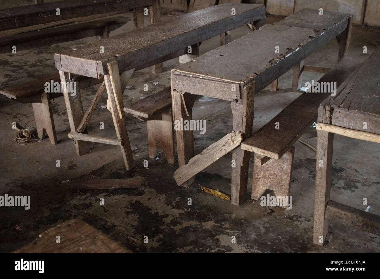 Old Broken Wooden Tables And Benches In Poor Condition Serve Students At A Primary School