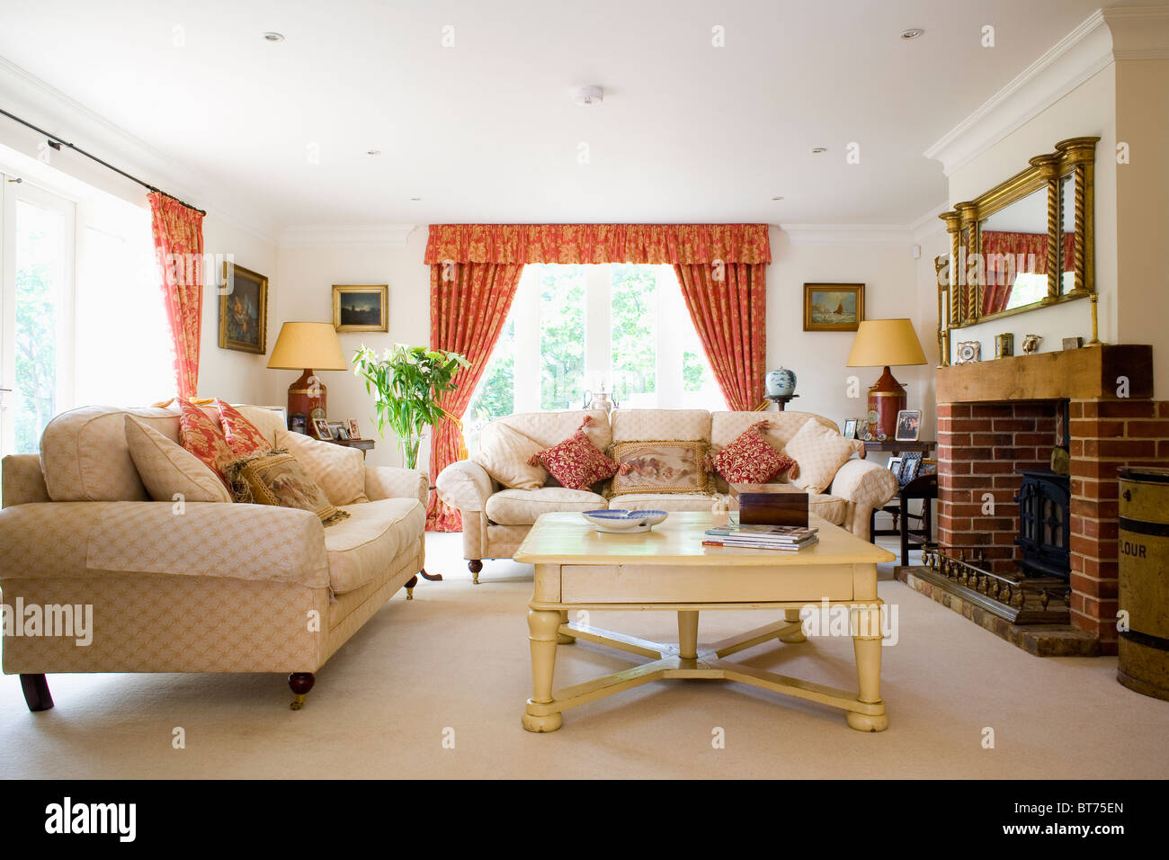 Cream Painted Coffee Table And Cream Sofas In Front Of Fireplace In Modern Living  Room Extension With Dark Orange Curtains Part 94