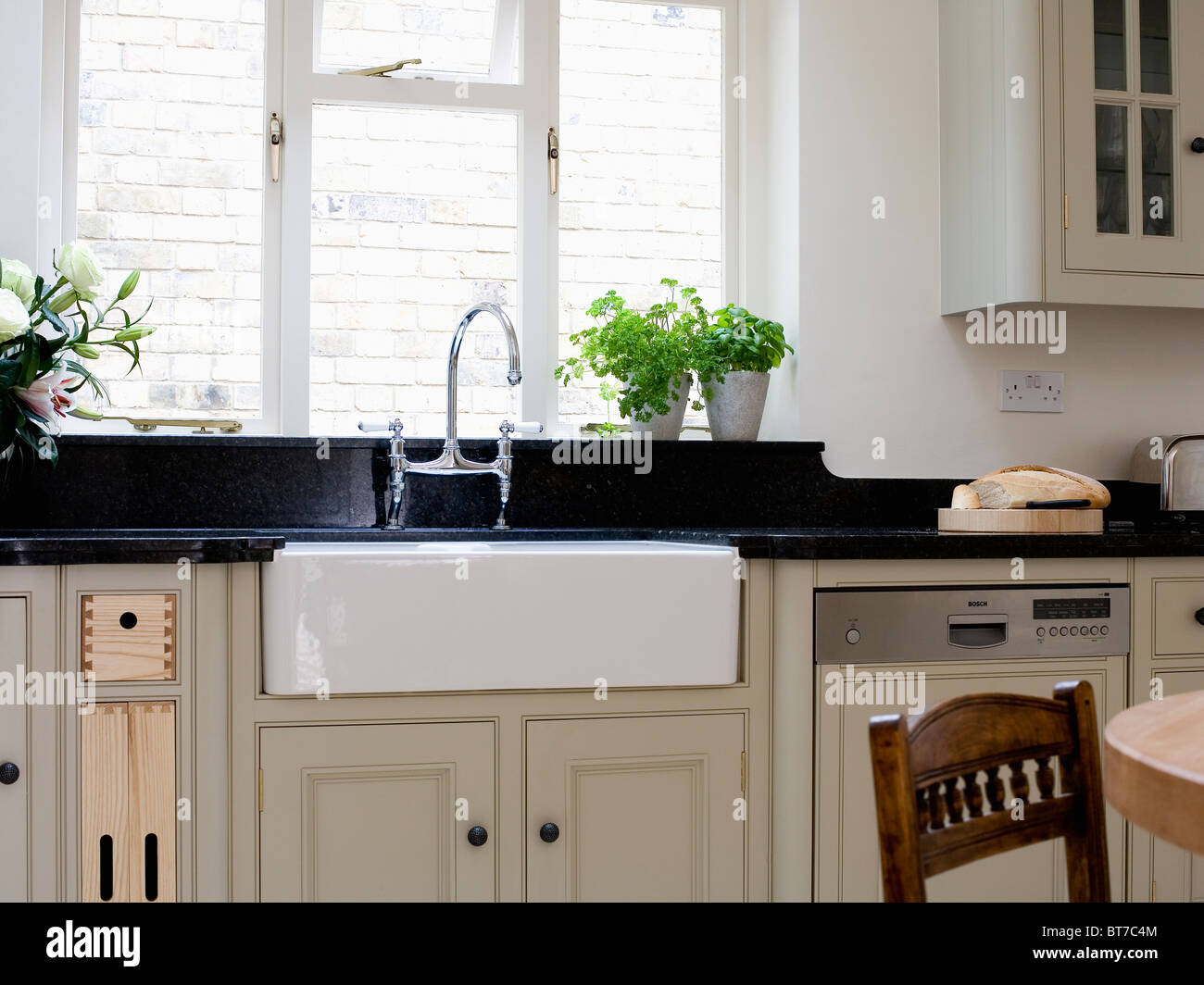 Belfast Sink Below Window In Traditional Kitchen With Pale Beige Stock Photo Royalty Free Image