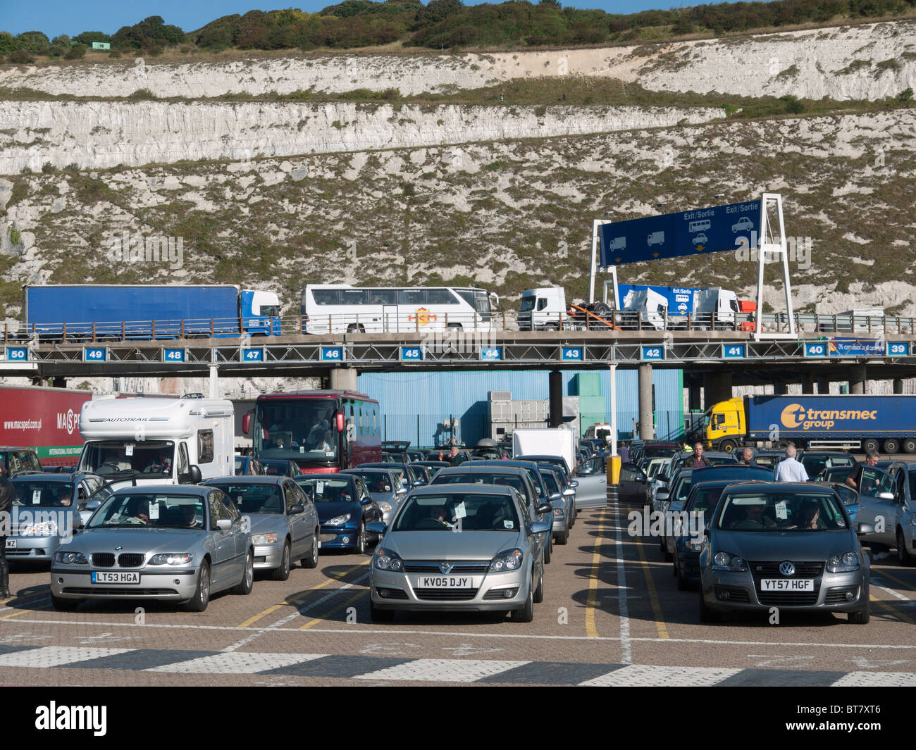 Cars Queue To Board At Dover Ferry Port As Arriving Lorries Leave