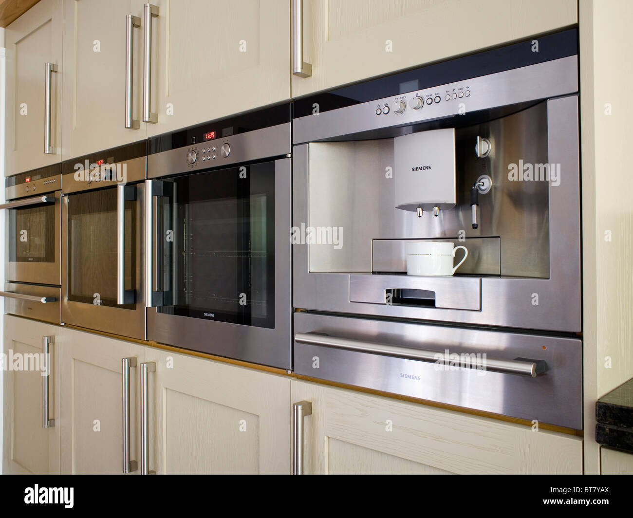 Fitted Kitchen Integral Oven In Fitted Unit In Modern Country Kitchen With Pale