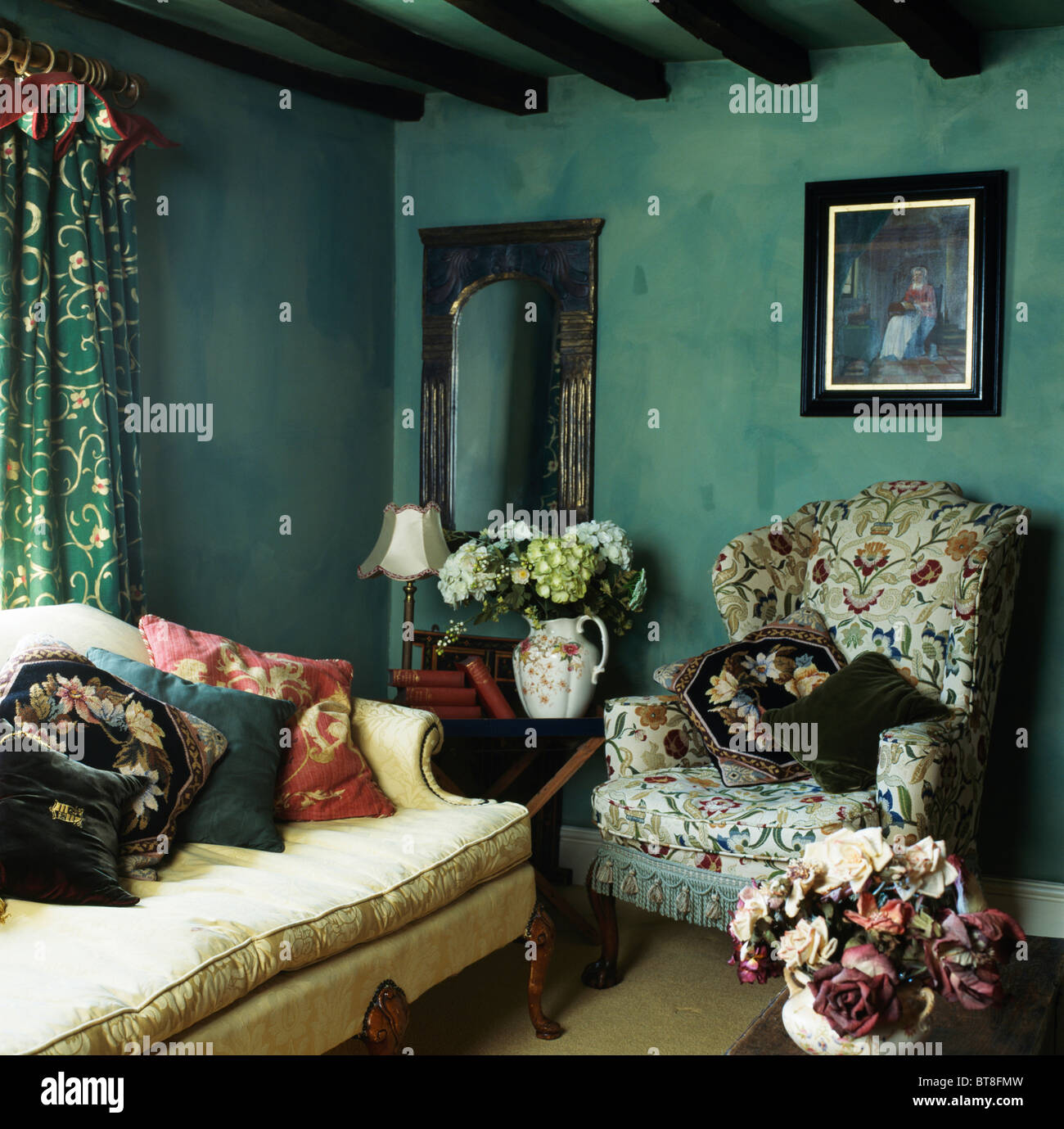 Picture On Wall Above Patterned Wing Chair In Dark Green Cottage Living Room With Sponge Effect Painted Walls