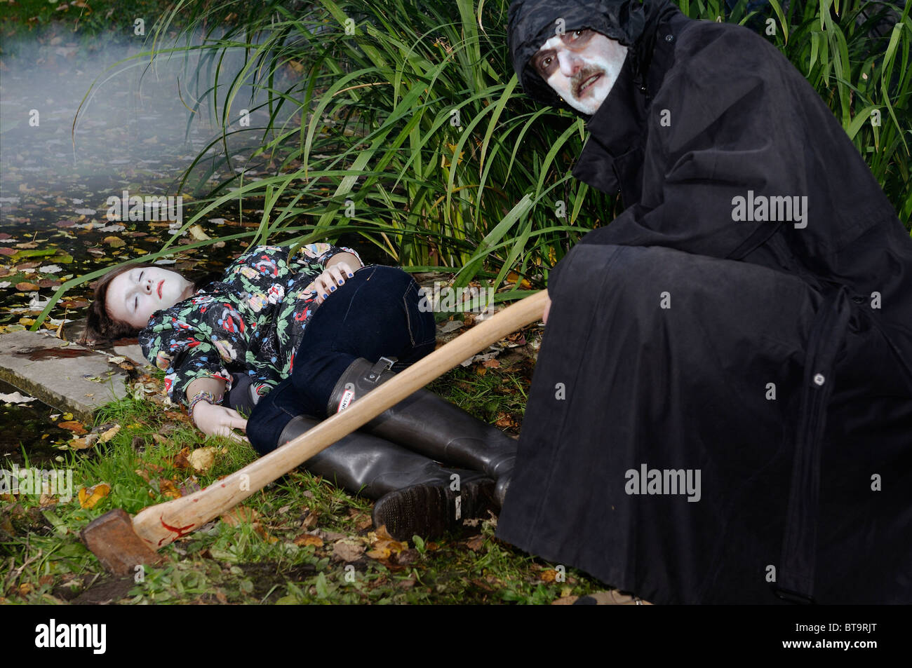 Murderous Evil Man In Black Coat With Axe Crouching Over A ...