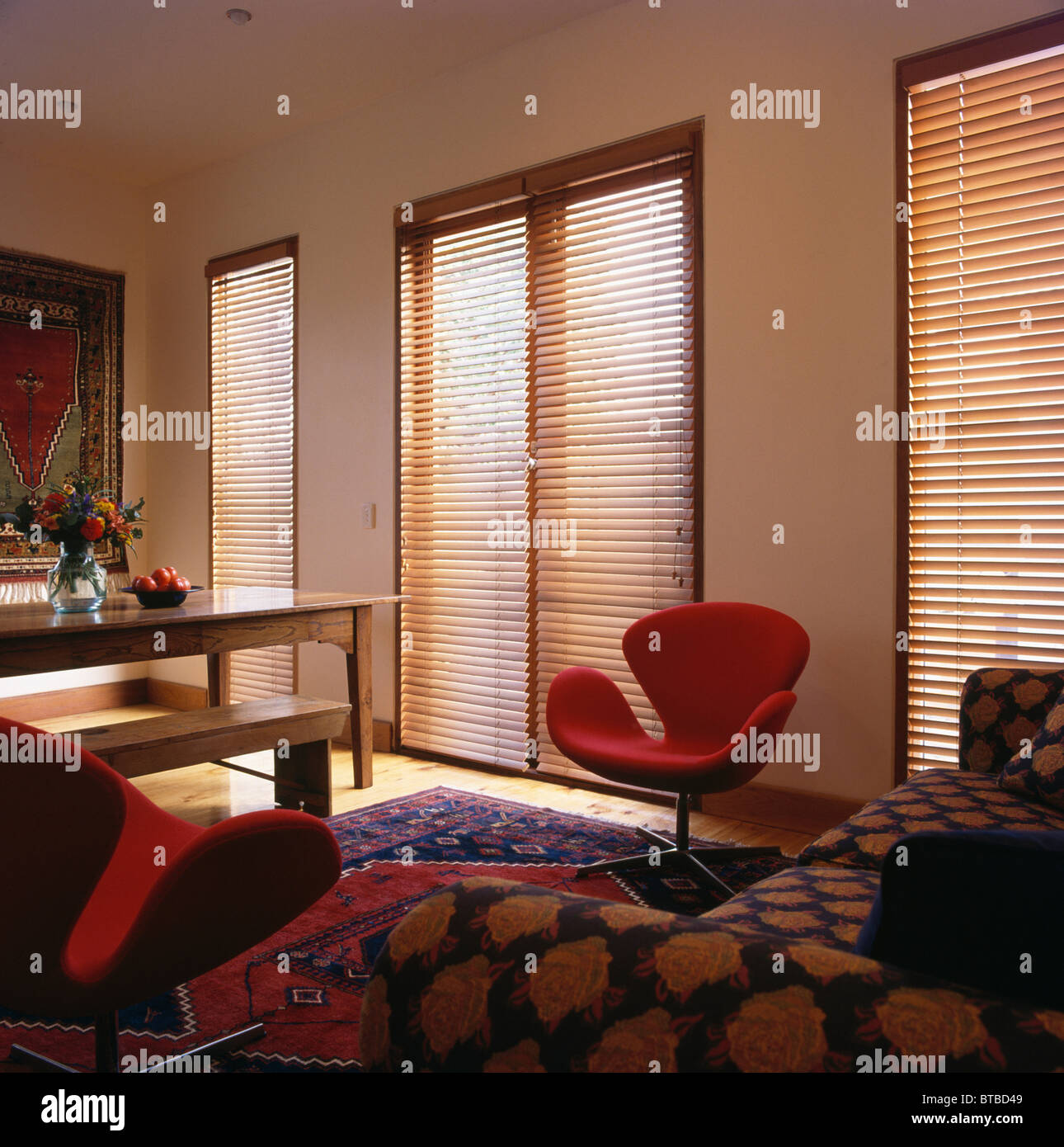 Slatted wooden blinds on tall windows in modern living for Blinds for tall windows