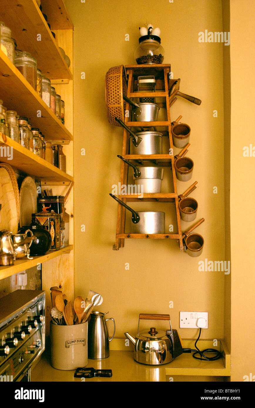 Kitchen Pan Storage Saucepans On Graduated Pan Storage Shelves On Wall Above Electric