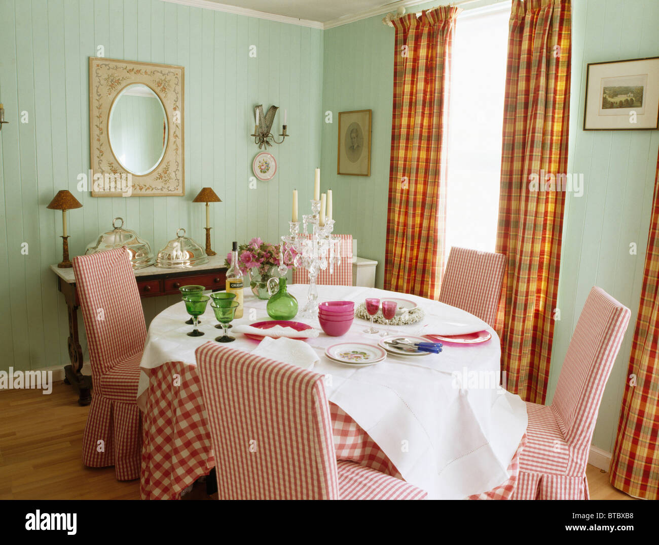 Red white checked upholstered chairs in pale green dining room with stock photo royalty free - Pale green dining room ...